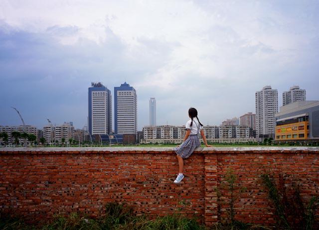 Weng Fen Sitting on the wall, Guangzhou, 2004